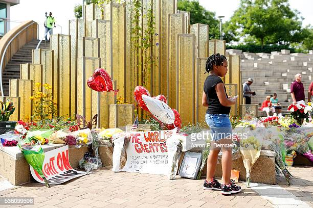 Mourners gather at a memorial following the death of boxing legend Muhammad Ali outside the Muhammad Ali Center June 4 2016 in Louisville Kentucky...