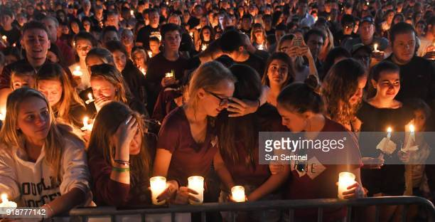 Mourners gather at a vigil that was held for the victims of the mass shooting at Marjory Stoneman Douglas High School in Parkland Fla on Thursday Feb...