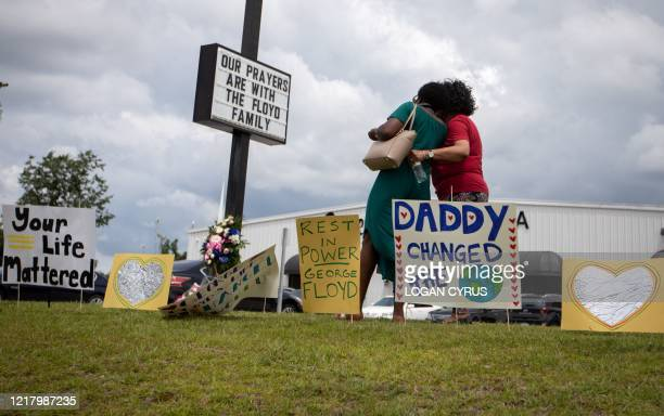 Mourners gather at makeshift memorial for George Floyd during his public viewing on June 6 at Cape Fear Conference B Church in Raeford North Carolina...