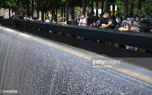 Mourners gather at the 9/11 Memorial & Museum in New York on September 11 as the US commemorates the 19th anniversary of the 9/11 attacks.