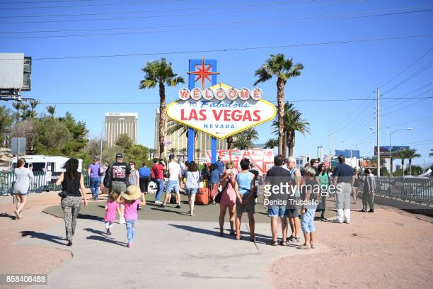 Mourners gather at the Welcome to Fabulous Las Vegas sign where Greg Zanis a retired carpenter from Illinois placed 58 crosses to honor those who...
