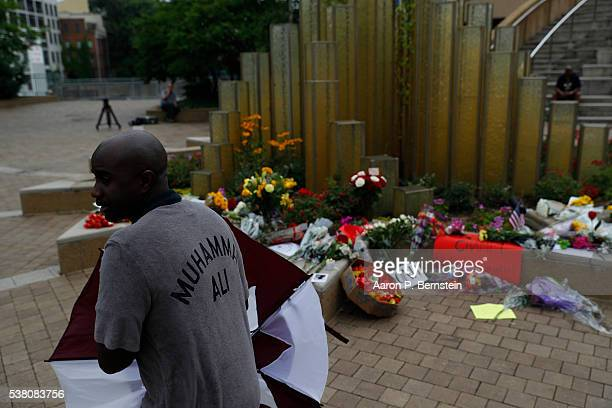Mourners gather following the death of boxing legend Muhammad Ali outside the Muhammad Ali Center June 4 2016 in Louisville Kentucky Ali died at a...