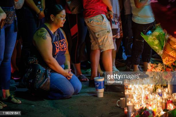 Mourners gather for a vigil at a memorial outside Cielo Vista Walmart in El Paso, Texas, U.S., on Wednesday, Aug. 7, 2019. Donald Trump sought to...
