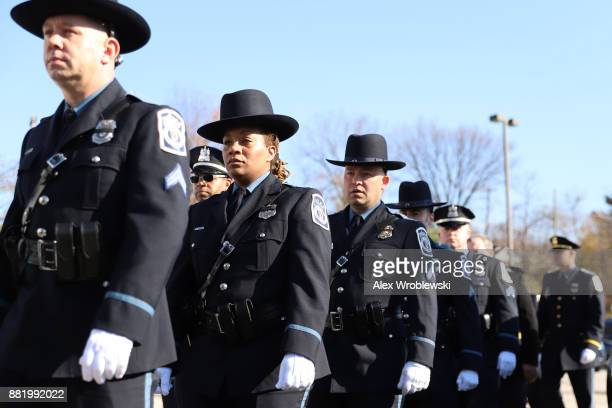 Mourners gather for the funeral of Detective Sean Suiter on November 29 2017 in Baltimore Maryland Suiter a detective in the homicide unit of the...