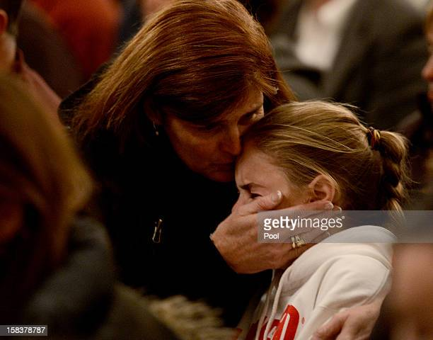 Mourners gather inside the St Rose of Lima Roman Catholic Church at a vigil service for victims of the Sandy Hook School shooting December 14 2012 in...