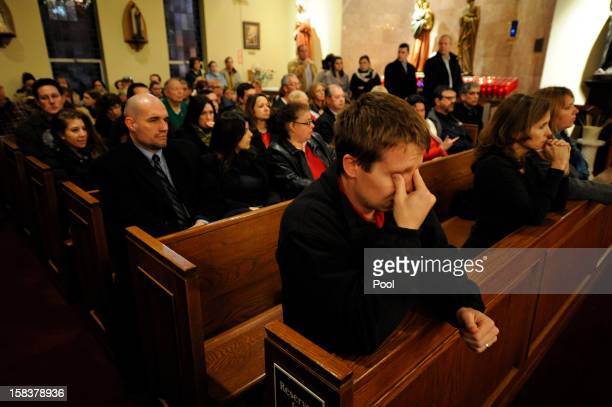 Mourners gather inside the St. Rose of Lima Roman Catholic Church at a vigil service for victims of the Sandy Hook School shooting December 14, 2012...