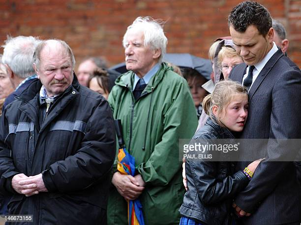 Mourners gather outside St Mary's Church in Derby central England on June 22 for a funeral service for six children Duwayne Jade John Jack Jesse and...