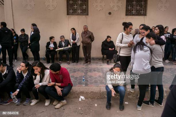 Mourners gather outside the Mar Girgis church for a funeral April 10 2017 in Tanta Egypt The main funeral was held the night of the attack but one...