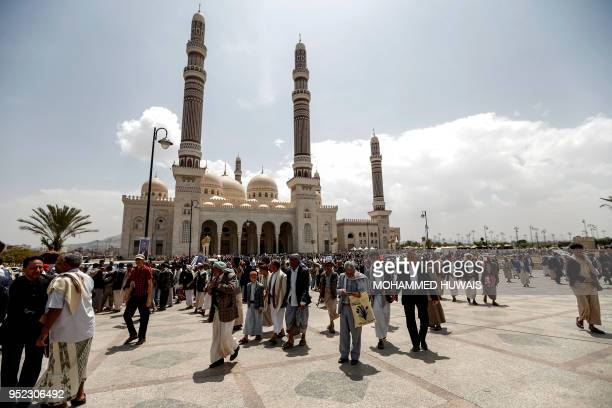 Mourners gather outside the mosque where the funeral of slain Huthi leader Saleh alSamad and his six bodyguards is held in the Yemeni capital Sanaa...