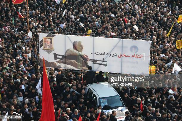 Mourners gather to pay homage to slain Iranian military commander Qasem Soleimani Iraqi paramilitary chief Abu Mahdi alMuhandis and other victims of...