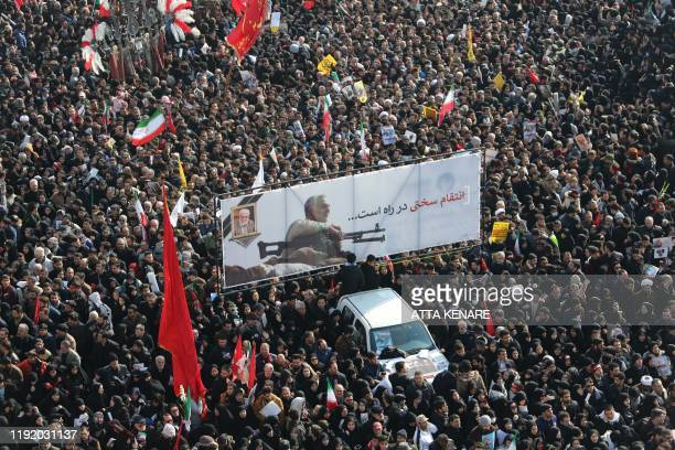 TOPSHOT Mourners gather to pay homage to slain Iranian military commander Qasem Soleimani Iraqi paramilitary chief Abu Mahdi alMuhandis and other...