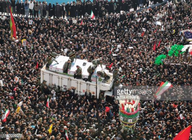 Mourners gather to pay homage to top Iranian military commander Qasem Soleimani, after he was killed in a US strike in Baghdad, in the capital Tehran...