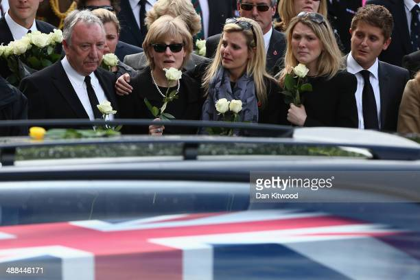 Mourners gather to pay their respects as the cortege passes by following the repatriation of five British servicemen who were killed in a helicopter...