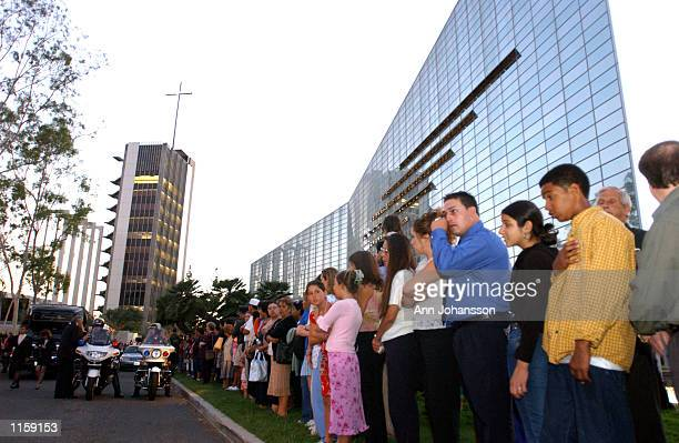 Mourners gather to say goodbye to 5 year old Samantha Runnion after her funeral at the Crystal Cathedral on July 24, 2002 in Garden Grove,...