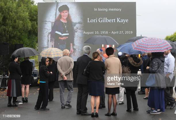 Mourners gather to watch a video broadcast in the overflow section at the funeral for Lori Kaye, who was killed on Saturday inside the Chabad of...