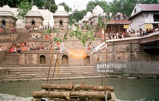 Mourners gather to witness the cremation ceremony of the Nepalese royal family at Pashupati Nath Arya Ghhat June 2 2001 in Kathmandu The King Queen...