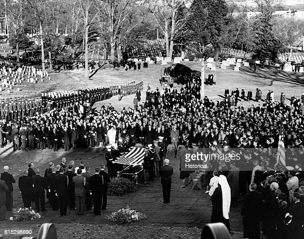 Mourners gathered at Arlington National Cemetery for the burial ceremony for assassinated president John F Kennedy