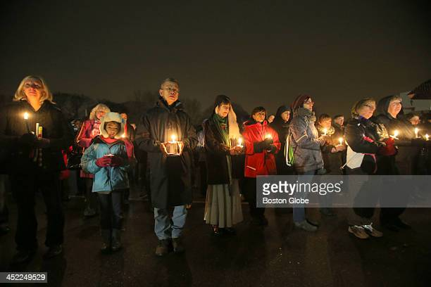 Mourners gathered for a candlelight vigil for Mei Kum Jones and her twin sons at Peirce Elementary School on the day the children would have...