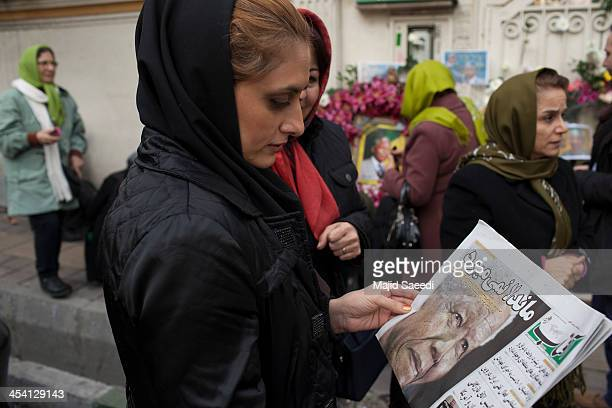 Mourners gathered in front of the South African embassy to pay their respects to the memory of Nelson Mandela on December 7 2013 in Tehran Iran...