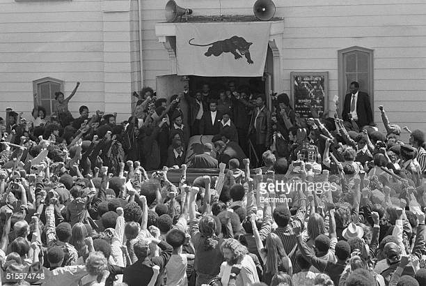 Mourners give the Black Panther salute as the casket of George Jackson is carried from St Augustine's Church in Oakland California Jackson a Black...