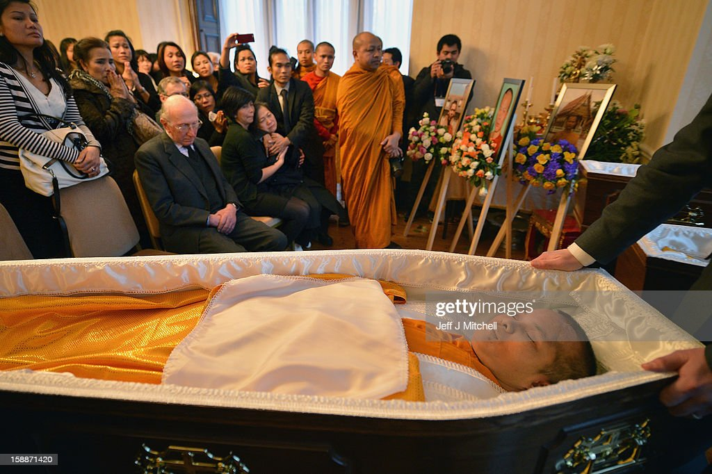 Mourners grieve at a service of remembrance for three thai Buddhist Monks who died in a car crash on Christmas Eve, at Oakvale Funeral Home on January 2, 2013 in Edinburgh, Scotland. Abbot Phramaha Pranom Thongphaiboon, 43, head of the Thai Buddhist community in Aberdeen, was killed in a car crash on Christmas Eve along with his colleagues Phramaha Kriangkrai Khamsamrong, 35, and Phramaha Chai Boonma, 36. The three men were travelling to the Dhammapadipa Temple in Edinburgh when they were involved in the head-on collision on the A68 near Pathhead, Midlothian.