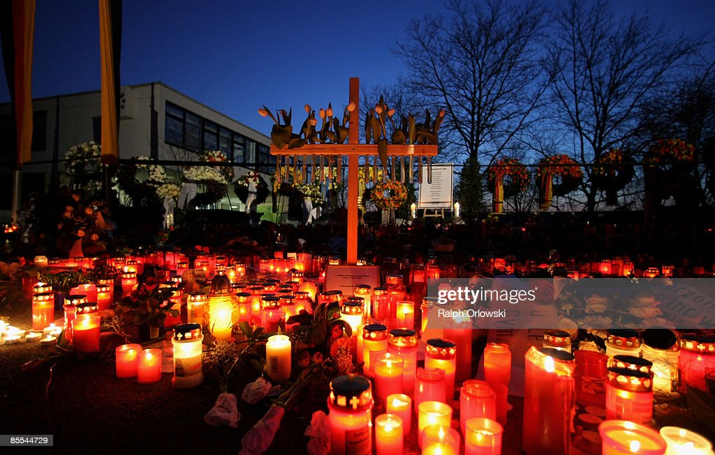 Mourners have placed candles outside the high school during the day of a memorial service on March 21, 2009 in Winnenden near Stuttgart, Germany. President Koehler, Chancellor Merkel and thousands of mourners hold a memorial ceremony to commemorate the victims of a school shooting. 17 - year old Tim Kretschmer opened fire on Wednesday, March 11, 2009 on teachers and pupils at his former school, killing 15 people and leaving many more injured. Kretschmer fled the scene and shot himself dead after being cornered by police.