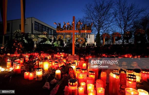 Mourners have placed candles outside the high school during the day of a memorial service on March 21 2009 in Winnenden near Stuttgart Germany...