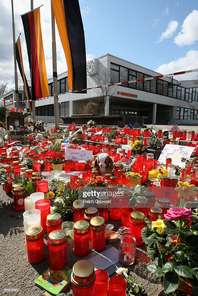 Mourners have placed candles outside the high school on March 20, 2009 in Winnenden near Stuttgart, Germany. 17 - year old Tim Kretschmer opened fire on Wednesday, March 11, 2009 on teachers and pupils at his former school, killing 15 people and leaving many more injured. Kretschmer fled the scene and shot himself dead after being cornered by police. Tommorow German President Horst Koehler, German Chancellor Angela Merkel and ten-thousands of mourners are expected to hold a memorial ceremony to commemorate the victims.
