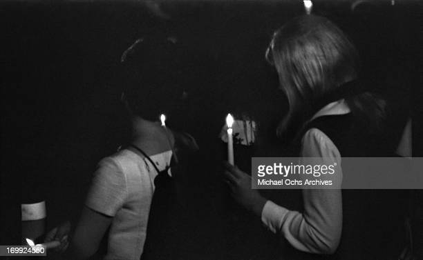 Mourners hold a candlelight vigil at Arlington National Cemetery during the funeral of Senator Robert Kennedy on June 9 1968 in Arlington County...