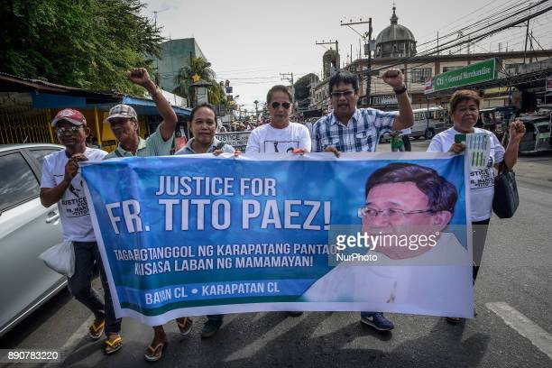 Mourners hold up a streamer as they take part in a march during the funeral of activist priest Fr Marcelito quotTitoquot Paez in San Jose Nueva Ecija...