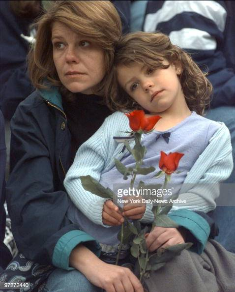 Columbine High School Shootings In Littleton Colorado: Mourners Holds Flowers At Columbine High School In
