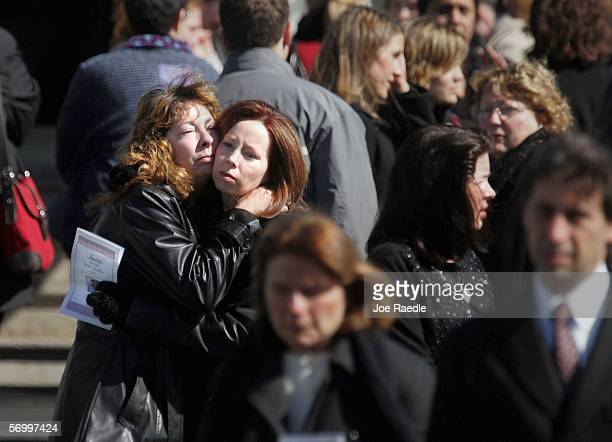 Mourners hug as they exit the Gormley Funeral Home after attending the funeral service for John Jay graduate student Imette St Guillen March 4 2006...
