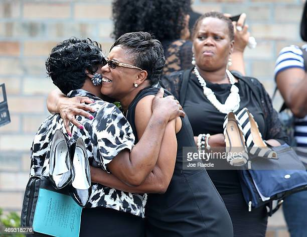 Mourners hug as they wait to enter the WORD Ministries Christian Center for the funeral of Walter Scott after he was fatally shot by a North...