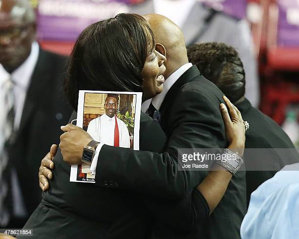 Mourners hug before the funeral begins at the College Charleston TD Arena where President Barack Obama is scheduled to deliver the eulogy for South...