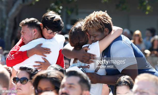 TOPSHOT Mourners hug during a prayer vigil for the victims of the Marjory Stoneman Douglas High School shooting at Parkridge Church in Coral Springs...