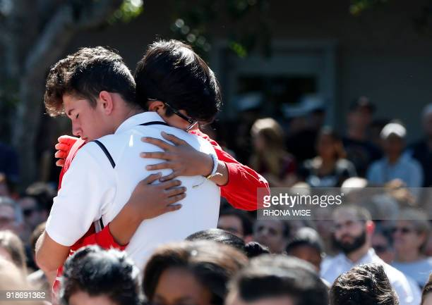 Mourners hug during a prayer vigil for the victims of the Marjory Stoneman Douglas High School shooting at Parkridge Church in Coral Springs Florida...