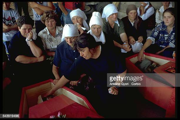 Mourners in Rogova Kosovo attend the funeral of Kosovo Liberation Army soldiers who were killed during the Yugoslavian Civil War In the late 1990s...