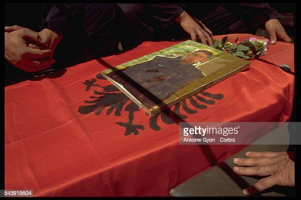 Mourners in Rogova, Kosovo, stand over the coffin of a Kosovo Liberation Army soldier who was killed during the Yugoslavian Civil War. In the late...