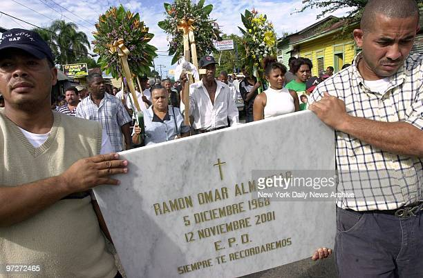 Mourners in the town of Yamasa carry a marble slab for the crypt of Ramon Almanzar killed in the crash of American Airlines Flight 587
