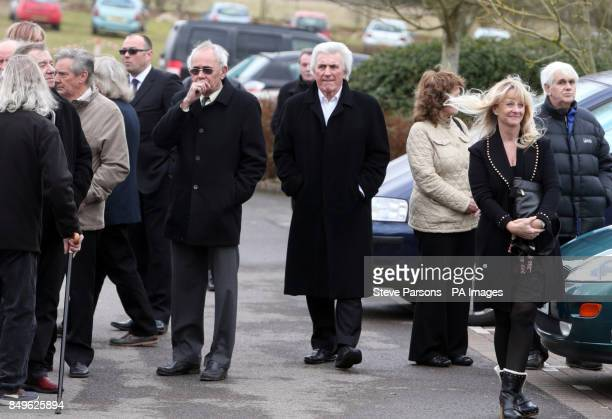 Mourners including Bruce Welch at the funeral of Troggs frontman Reg Presley held at Basingstoke Crematorium Hampshire Presley was the singer with...