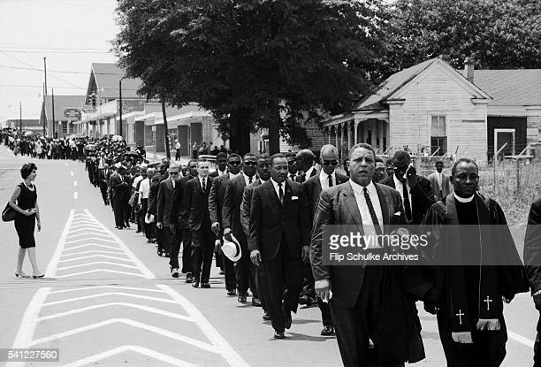 Mourners including Martin Luther King Jr march through Jackson Mississippi in a funeral procession for slain civil rights leader Medgar Evers