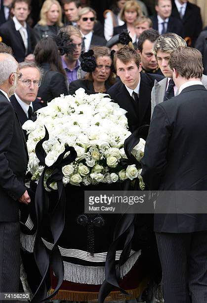 Mourners including Ottis Ferry help as the coffin is lowered at the funeral service for fashion stylist Isabella Blow at Gloucester Cathedral on May...