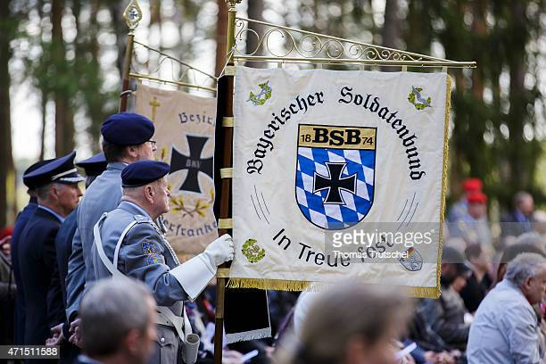 Mourners including representatives of the Bavarian Soldiers Federation holding their banner attend a ceremony held by the German Wargraves Commission...