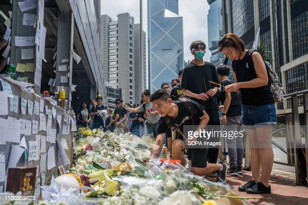 Mourners laid flowers to pay respect to a person who fell from a scaffolding the day before after hanging an antiextradition law banner Millions of...