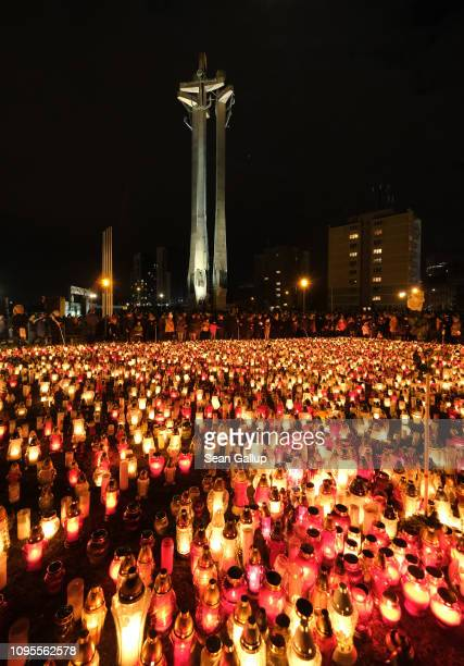 Mourners lay candles for murdered Gdansk mayor Pawel Adamowicz near the European Solidarity Centre where Adamowicz's coffin was laid to public view...