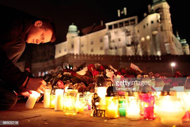 Mourners lay candles in memory of late Polish President Lech Kaczynski in front of the 'Katyn 1940' memorial nearby the Castle Wawel on April 16 2010...