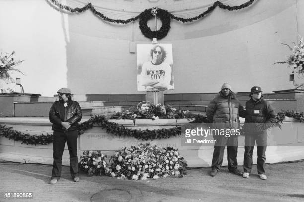 Mourners lay flowers and wreaths at the John Lennon memorial in Central Park's Naumburg Bandshell New York City December 1980