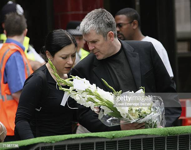 Mourners lay flowers at a ceremony to remember the victims of 7/7 bombings at Russell Square underground station on July 7 2006 in London England On...