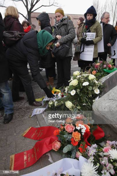 Mourners lay flowers at the memorial to Hatun Surucu on the 7th anniversary of her murder near the site where Surucu was killed on February 7 2012 in...