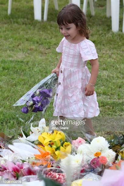 Mourners lay flowers during a vigil to remember murdered mother Hannah Clarke and her three children at Bill Hewitt Reserve in Camp Hill on February...